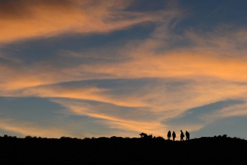 Hikers at Sunset || Arches NP
